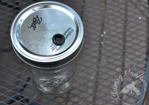 Changing a Mason Jar lid into a travel cup