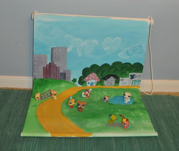 kids playmat that is wall mounted and made from a white roller blind