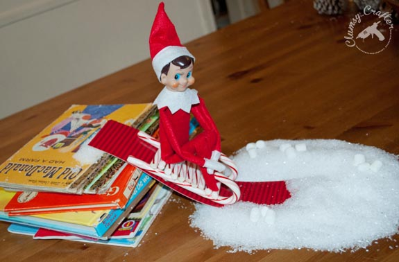 Elf on the Shelf Idea - elf on a candy cane sled