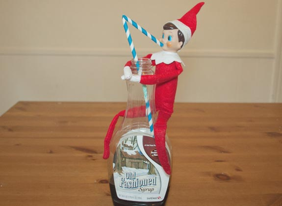 Elf on the shelf ideas - Elf drinking the syrup