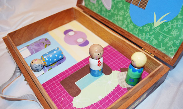 Peg Doll House made from a cigar box with Mod Podge and scrapbook paper!
