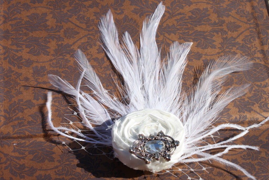 white feather hair piece from Victoria Kate Boutique on Etsy