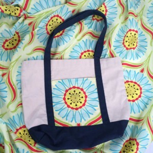 How to take and old promotional tote to a really cute bag! Repurpose and resue!