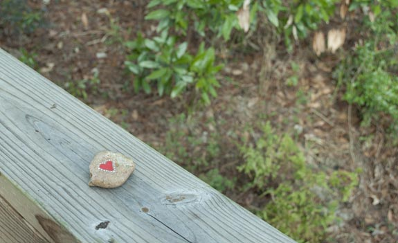 leave rocks with hearts and messages on the back for strangers to find