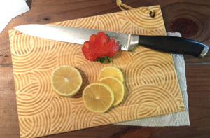 Place A Wet Paper Towel Under Your Cutting Board To Keep It From