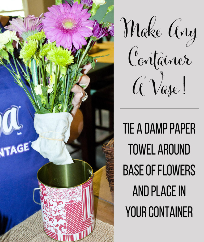 tie a damp paper towel around the base of flower stems to turn any containter into an instant vase