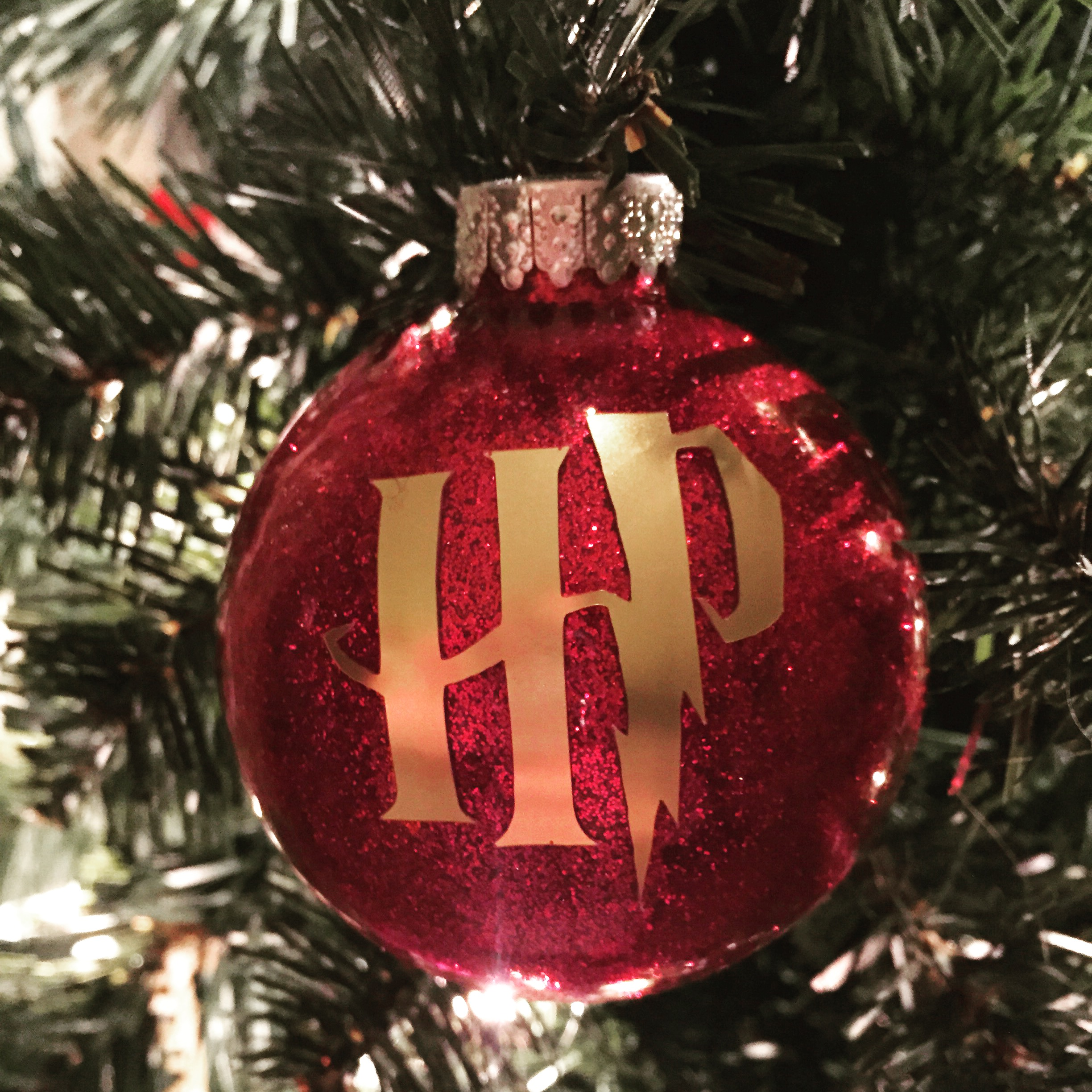 Harry Potter Ornament made with a DIY Glitter ornament and cricut vinyl
