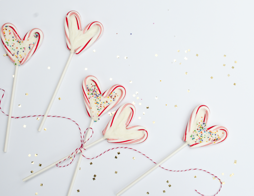 Melted chocolate heart lollipops for valentine's day using mini candy canes